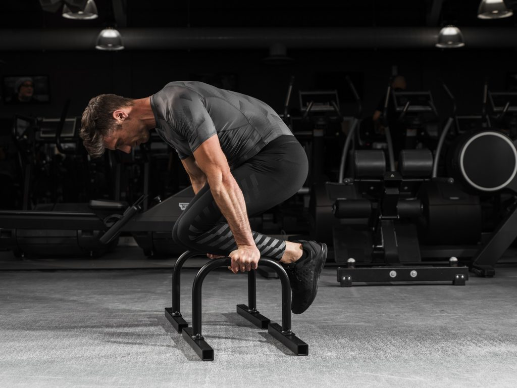 How to perform Tuck Planche Push-ups on Medium Parallettes - Auster