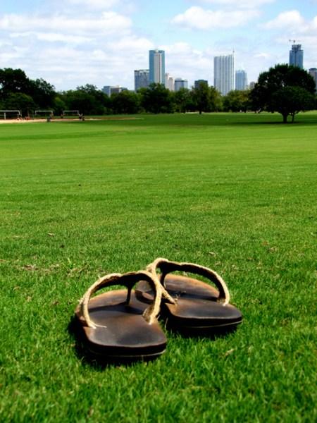 zilker park sandals hipster city skyline downtown grass field lawn
