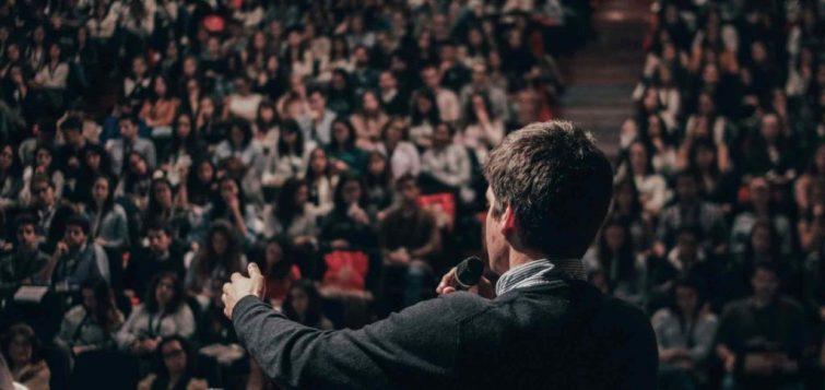 Man giving speech to an audience.