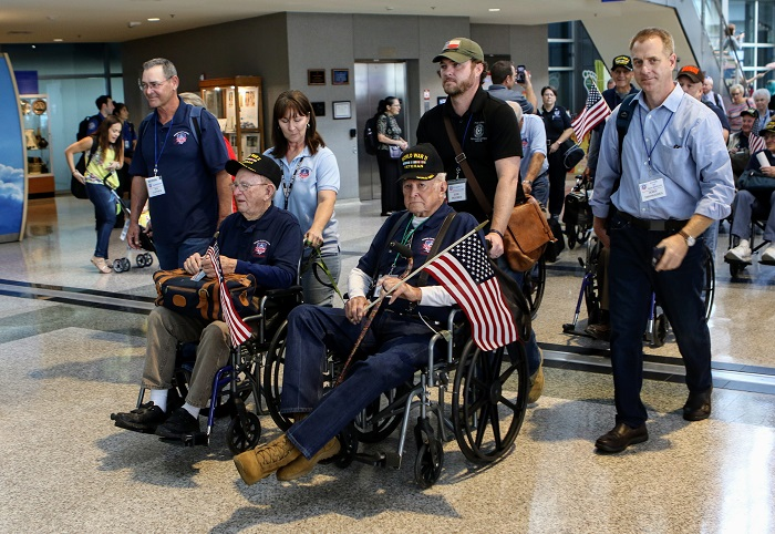 Veterans head to their gate as part of the Honor Flight 53 procession.