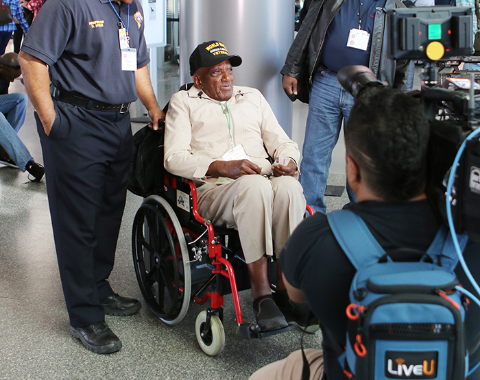 An Honor Flight Austin veteran is interviewed by the media.