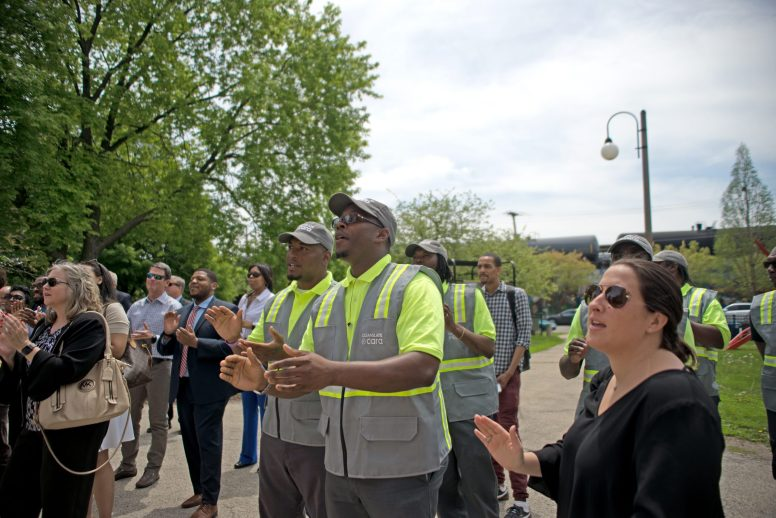 STARTING OVER: Cleanslate workers during a May 17 press conference held to announce that the organization's Ward by Ward initiative will expand into Austin's 29th Ward. | ALEXA ROGALS/Staff Photographer