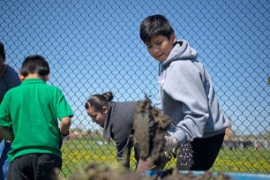 Digging in the dirt: Neighbors and students began work at Chicago Farm Lab in the first weekend of May. Farm Lab organizer Marnie Ware says fundraising efforts are ongoing for the 2-acre urban farm. | ALEXA ROGALS/Staff Photographer