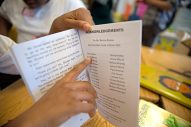 Student Darnell Allen points to his name in the book's acknowledgement page last Friday, during a book launch party at Ella Flagg Young Elementary School in Austin. | ALEXA ROGALS/Staff Photographer