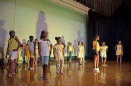Students walk down the stage wearing darker clothing last Friday, during the annual Exclusive Spring Fashion Show inside the auditorium at Ella Flagg Young Elementary School in Chicago's Austin neighborhood. | Photos by ALEXA ROGALS/Staff Photographer