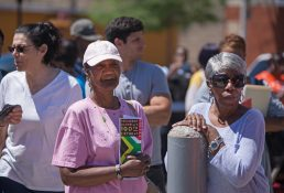 Residents listen to speakers on Wednesday, during the Mandela's 5th annual street dedication and 100th birthday celebration outside of the Westside Health Authority on Chicago Avenue in Austin. | ALEXA ROGALS/Staff Photographer