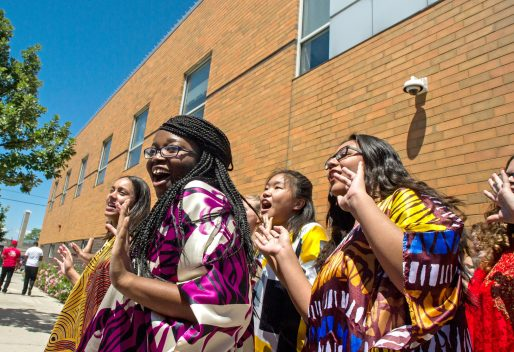 Members from the HHW Vocal Arts Ensemble sing on Wednesday, during the Mandela's 5th annual street dedication and 100th birthday celebration outside of the Westside Health Authority on Chicago Avenue in Austin. | ALEXA ROGALS/Staff Photographer