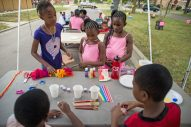 What's your inspiration?: Children gather around a table and make necklaces with handmade clay pieces last Saturday, during the Awesome Austin Art Affair on West End and Mayfield Avenues in Austin. | ALEXA ROGALS/Staff Photographer
