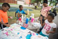 Children add colors and designs to a canvas last Saturday, during the Awesome Austin Art Affair on West End and Mayfield Avenues in Austin. | Photos by ALEXA ROGALS/Staff Photographer