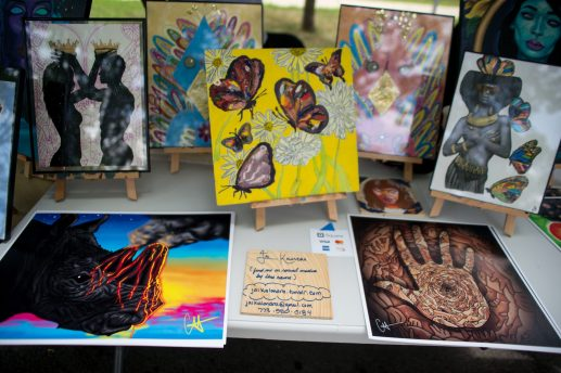 Artwork is displayed at a booth for attendees to purchase and view last Saturday, during the Awesome Austin Art Affair on West End and Mayfield Avenues in Austin. | Photos by ALEXA ROGALS/Staff Photographer