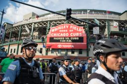 Chicago police officers block off the entrance to Wrigley Field on Thursday, during an anti-violence protest in Chicago. | ALEXA ROGALS/Staff Photographer
