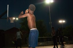 Even after the festivities ended, young men played basketball well into the night. | Shanel Romain/Contributor