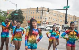 All smiles: A group of dancers walk along the route on Saturday, during Congressman Danny Davis' annual Back 2 School parade on Central Avenue in Austin.