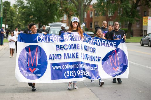 Children with College Mentoring Experience hold up a banner and walk along the route last Saturday, during Congressman Danny Davis' annual Back 2 School parade on Central Avenue in Chicago's Austin neighborhood. | Photos by ALEXA ROGALS/Staff Photographer