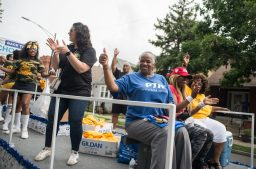 Attendees cheer on a float and wave to residents last Saturday, during Congressman Danny Davis' annual Back 2 School parade on Central Avenue in Chicago's Austin neighborhood. | Photos by ALEXA ROGALS/Staff Photographer