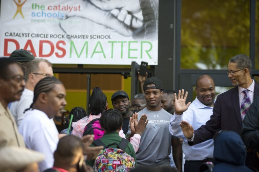 Great day: Students walk into school on Wednesday, Sept. 12, during the Dads Take Your Child To School day at Catalyst Circle Rock Charter School on Washington Boulevard in Austin. | ALEXA ROGALS/Staff Photographer