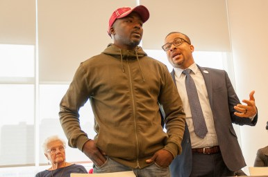 Ald. Michael Scott, Jr. (24th), tries calming down activist Mark Carter during the press conference. | SHANEL ROMAIN/Contributor