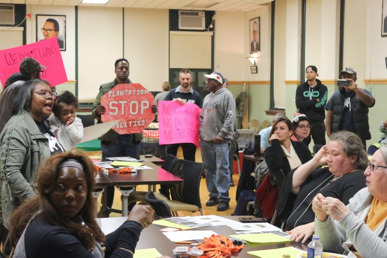 PUSH BACK: Members of the D20 Army Community Battle Group, an anti-gentrification group in Garfield Park, during a meeting on the Garfield Park Eco Orchard on Oct. 22. | SARAH CONWAY/City Bureau