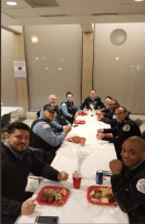 Catholic Charities of Chicago serving a great holiday meal to first watch officers. | Photos courtesy 15th District Police