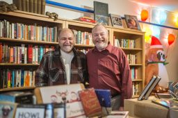 CROSSING AUSTIN BLVD.: Bill Fletcher and Don Moss inside of their new bookstore, Jake's Place, in Oak Park. The couple recently donated a dozen books to Ellington Elementary School in Austin. | ALEXA ROGALS/Staff Photographer