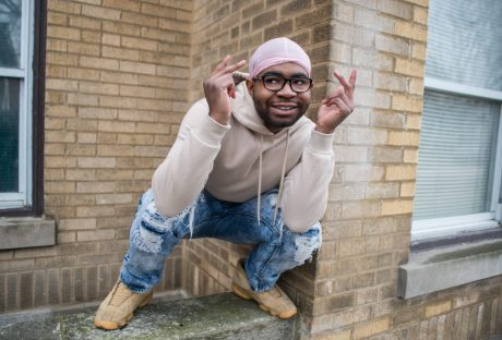 Something to say: Chicago-based rapper Charles Donalson, also known as Dahzi, poses for a photo on Dec. 28 outside of his family's old home on Kenilworth Avenue in Oak Park, | ALEXA ROGALS/Staff Photographer