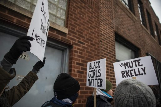 Protesters hold up signs and chant on Saturday, Jan. 12, during a Mute R. Kelly protest outside of his studio on Justine Street in Chicago. | ALEXA ROGALS/Staff Photographer