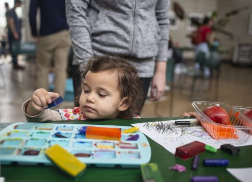Athena Saleh, 2, of Oak Park, plays with slices of fruit and uses them as stamps on Saturday, March 2, during the Nature Play workshop at the Garfield Park Conservatory. | ALEXA ROGALS/Staff Photographer
