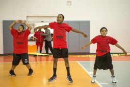 The St. Paul team warms up with jumping jacks on Saturday, March 9, during the Community Works and Sports Alternative Youth Olympics event at the By The Hand Club For Kids in Austin. | ALEXA ROGALS/Staff Photographer