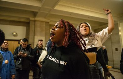Activists with NoCopAcademy protest the 5mil Cop Academy to go up in West Garfield Park on Wednesday, March 13, during the protest outside of council chambers on the second floor of Chicago City Hall on LaSalle Street. | ALEXA ROGALS/Staff Photographer