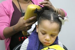 FIRST CALM, THEN COMB: A white family adopted Carnia Basi, 3, (left), when she was five-days old. Her adopted mother said she brings her daughter to the nonprofit Styles 4 Kidz in Oak Park to get her hair done because she has not yet learned how to style black hair. | WENDELL HUTSON/Contributor