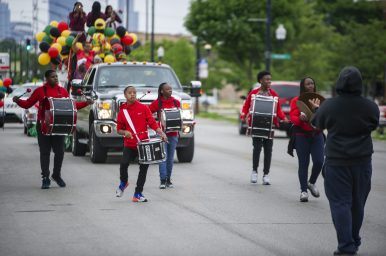 Parade participants and marching band, walk down the road carrying African flags last Saturday, June 15, during the fifth annual African-American Awareness and Appreciation Parade Juneteenth Celebration on Madison Street on the West Side. | ALEXA ROGALS/Staff Photographer