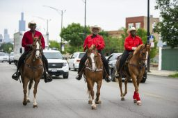 A group of horseback riders make their way down the route on Saturday, June 15, during the fifth annual African-American Awareness and Appreciation Parade Juneteenth Celebration on Madison Street on Chicago's Westside. | ALEXA ROGALS/Staff Photographer