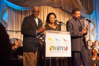 Howard and Darlene Sandifer present Robert Townsend with an award during a gala celebrating their organization's 20th anniversary. | SHANEL ROMAIN/Contributor