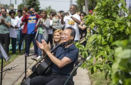 MA-RVELOUS: Cellist Yo-Yo Ma applauds the Children from Ravinia's Lawndale Family Music School after their performance on Friday, June 21, during the Yo-Yo Ma's Day of Action at Unity Park in Chicago's Homan Square neighborhood. | ALEXA ROGALS/Staff Photographer