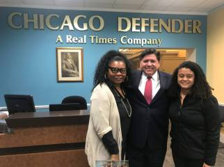 Submitted photos THE DEFENDER EXPERIENCE: Shari Noland, far left, with Gov. JB Pritzker and former Chicago Defender editor Marty Datcher in the Chicago Defender offices. Noland was the paper's executive editor for five months. | Submitted photo