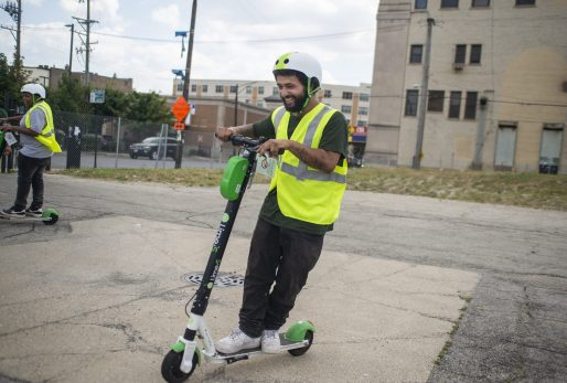 GIVING IT A WHIRL: Lime, an e-scooter vendor, holds an informational session on Aug. 7 in Humboldt Park. The event got more West Side residents interested in the low-key transportation device. | ALEXA ROGALS/Staff Photographer