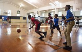 IT'S LIT: Kids play basketball together inside the gym on Sept. 13, during the Lights in the Night event at Columbus Park in Austin. | ALEX ROGALS/Staff Photographer