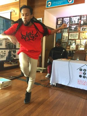 PUTTING THEM ON THE MAP: Break dancer Jarius King performs during on Sept. 7 at the West Side Justice Center. | BONNI McKEOWN/Contributor