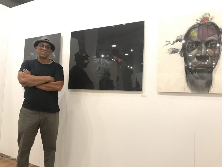 EARNING THEIR TRUST: Artist Jesse Howard is known for his charcoal drawings that convey the unvarnished reality of African Americans suspended in various degrees of marginality. | MICHAEL ROMAIN/Staff
