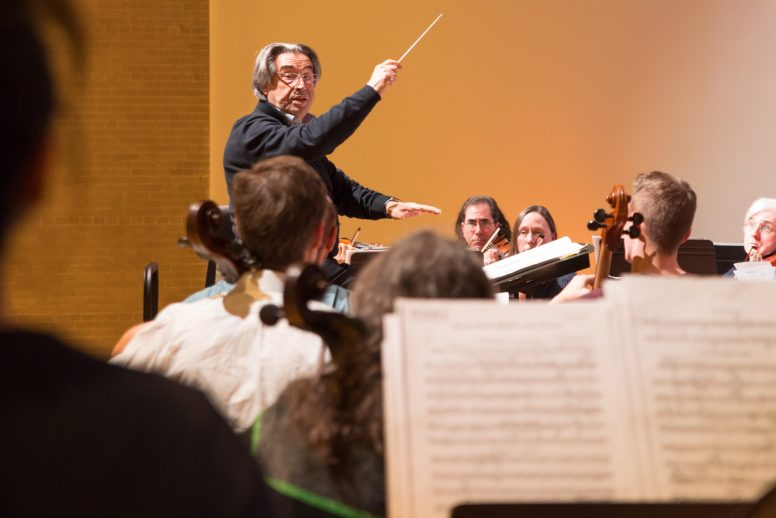 PLAYING PROKOFIEV: Riccardo Muti, the director of the Chicago Symphony Orchestra, conducts the Symphony of Oak Park and River Forest during a rehearsal held at the Kehrein Center for the Arts in Austin on Nov. 10. | SHANEL ROMAIN/Contributor