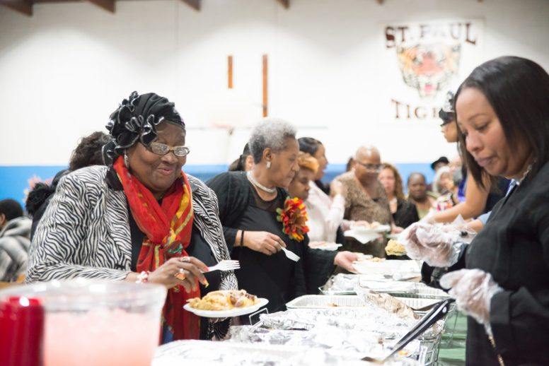 Grateful: Shirley Hill fixes her plate at the 12th Annual Soul Food Powwow, which was hosted by Roman Morrow and St. Paul Lutheran School inside the school's gymnasium on Nov. 24. | SHANEL ROMAIN/Contributor