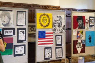 KEEPING HIS MEMORY ALIVE: The Fred Hampton-inspired artwork of Proviso East students on display at the high school last week. | SHANEL ROMAIN/Contributor