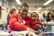 SWEET DREAMS: Tierra Collins, left, makes a cookie with Mia Richardson on Monday, Dec. 16, during a toy drive and holiday party at New Moms in Austin. | ALEX ROGALS/Staff Photographer
