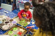 King Lee, decorates holiday cookies with his sister Jalynn Lee on Monday, Dec. 16, during a toy drive and holiday party at New Moms in Austin. | ALEX ROGALS/Staff Photographer