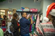 Volunteers help shoppers look for clothes and gifts for children on Dec. 16, during a toy drive and holiday party at New Moms in Chicago's Austin neighborhood. | ALEX ROGALS/Staff Photographer