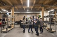 OPENING UP: Attendees mingle at new roastery for Passion House Coffee and Roasters in East Garfield Park. | ALEX ROGALS/Staff Photographer