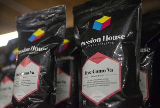 Bags of coffee beans are displayed at new roastery for Passion House Coffee and Roasters in East Garfield Park. | ALEX ROGALS/Staff Photographer