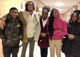 Imani Hardy with his teen mentees outside of the music studio. | BONNIE McKEOWN/Contributor