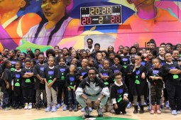 Pippen and Pondexter take a photo with the children at the Boys & Girls Club in Garfield Park, which recently received a new basketball court. | PASCAL SABINO/Contributor