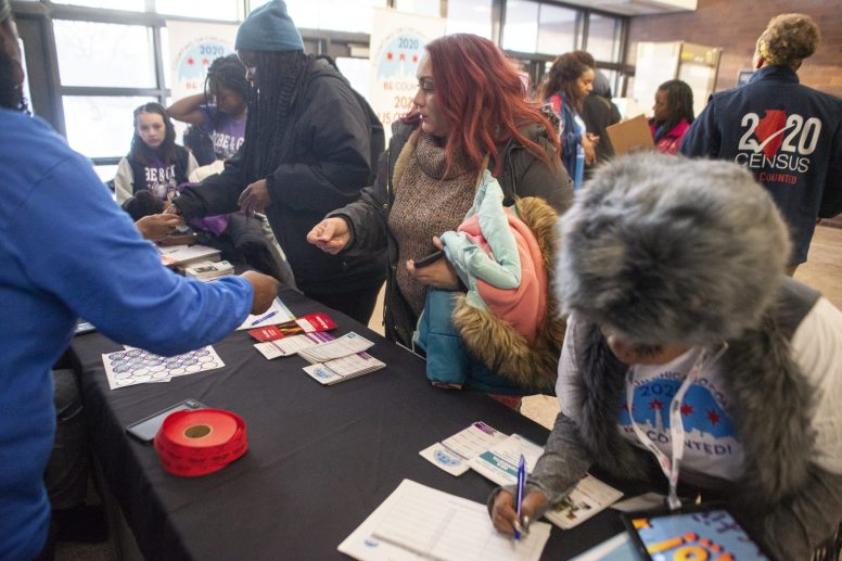Census All-Stars: Residents receive 2020 Census information during an NBA All-Star viewing party and Census Jumpoff at Collins Academy High School on Feb. 15. | ALEX ROGALS/Staff Photographer .